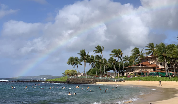 Poipu Beach with a rainbow